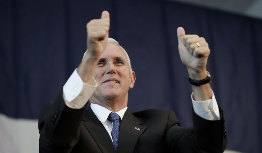 Republican vice presidential candidate, Indiana Gov. Mike Pence greets supporters during a campaign rally, Thursday, Oct. 27, 2016, in Fort Dodge, Iowa. (AP Photo/Charlie Neibergall)