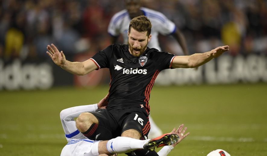 D.C. United forward Patrick Mullins (16) goes down against Montreal Impact defender Laurent Ciman, left, during the second half of an MLS playoff soccer match, Thursday, Oct. 27, 2016, in Washington. The Impact won 4-2. (AP Photo/Nick Wass) **FILE**