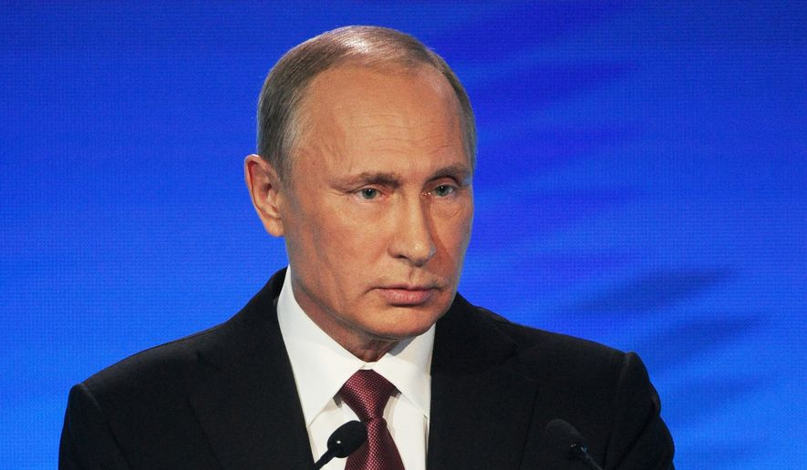 Russian President Vladimir Putin speaks at a meeting of the Valdai International Discussion Club in Sochi, Russia, Thursday, Oct. 27, 2016. President Vladimir Putin says the claims of Russia's interference in the U.S. presidential election are designed to distract public attention from real issues. (Mikhail Klimentyev/Pool Photo via AP)