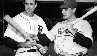 FILE - In this Oct. 4, 1945, file photo, Detroit Tigers leftfielder Hank Greenberg, left, and Chicago Cubs first baseman Phil Cavaretta, right, talk before Game 2 of baseball's World Series in Detroit. (AP Photo/File)