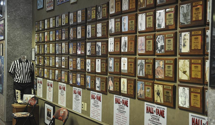 This Oct. 3, 2016 photo shows the interior of  the Professional Wrestling Hall of Fame and Museum in Wichita Falls, Texas, which features hundreds of photographs, outfits, props and a wide variety of other memorabilia in addition to the 169 inductees of the hall of fame. (Torin Halsey /Times Record News via AP)