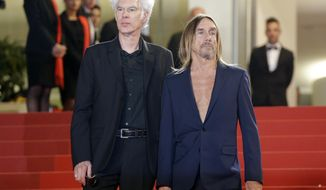 "FILE - In this May 20, 2016 file photo, director Jim Jarmusch, left and singer Iggy Pop, pose at the screening of the film ""Gimme Danger,"" at the 69th international film festival, Cannes, southern France. The film premieres Friday, Oct. 28, 2016, in Detroit and New York. (AP Photo/Lionel Cironneau, File)"