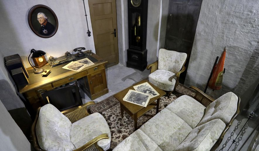 Interior view of a replica of the living room and office of Adolf Hitler pictured in a high-rise bunker, not the original so called 'Fuehrer's-Bunker', in Berlin, Germany, Thursday, Oct. 27, 2016. The room is part of an exhibition, located in a World War II high-rise bunker, which offers an overview of the history of Hitler's bunker and the end of the war. (AP Photo/Michael Sohn)