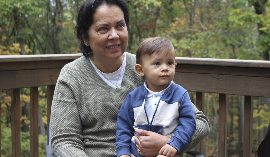 In this photo taken Oct. 13, 2016, Irma Hendricks poses for a portrait with her grandson, C.J., at her home in East Stroudsburg, Pa. Hendricks received a kidney transplant from a donor with hepatitis C, and took medications after surgery that cleared away the virus and left her feeling healthy again. Hendricks is part of a pilot study  testing if new drugs that promise to cure most hepatitis C could allow use of organs that today go to waste, and speed transplants to people who might otherwise die waiting. (AP Photo/Michael Rubinkam)