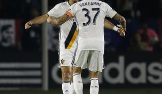 Los Angeles Galaxy defender Jelle Van Damme (37) congratulates forward Alan Gordon (9) for scoring against the Real Salt Lake during the first half of a knockout round MLS playoff soccer match in Carson, Calif., Wednesday, Oct. 26, 2016. (AP Photo/Alex Gallardo)