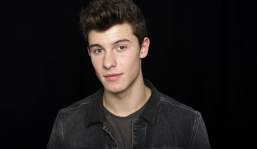 "In this Sept. 23, 2016 photo, singer Shawn Mendes poses for a portrait to promote his sophomore album ""Illuminate,"" in New York. (Photo by Scott Gries/Invision/AP)"