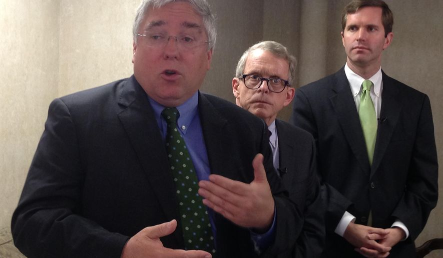 From left, Attorneys general Patrick Morrisey of West Virginia,  Mike DeWine of Ohio,  and Adam Beshear of Kentucky speak to the media Thursday, Oct. 27, 2016, before a conference on substance abuse in Huntington, W.Va. The conference was attended by dozens of law enforcement officers, health care professionals and faith-based groups. (AP Photo/John Raby)