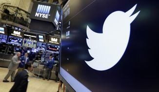 In this July 27, 2016, file photo, the Twitter symbol appears above a trading post on the floor of the New York Stock Exchange. (AP Photo/Richard Drew, File)
