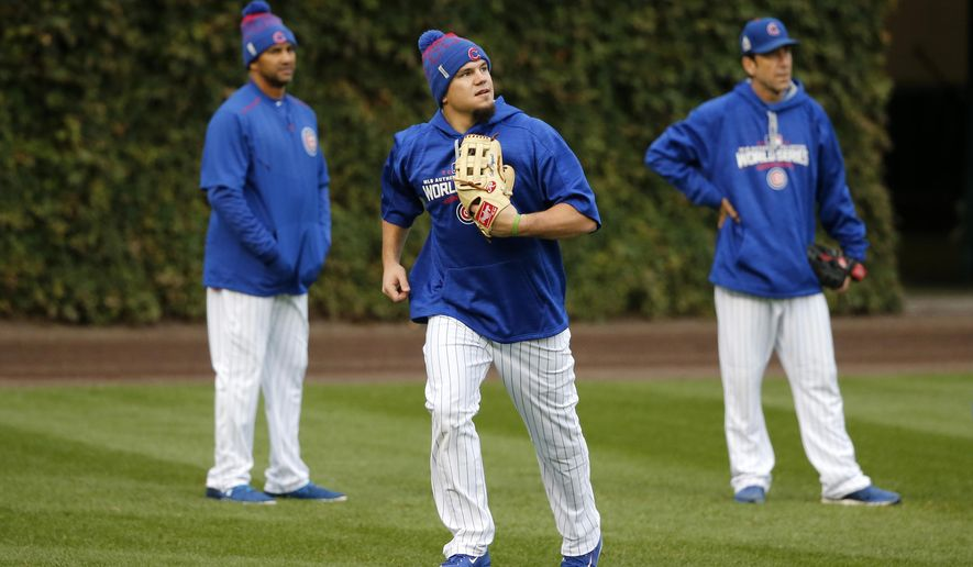 Chicago Cubs' Kyle Schwarber works out in the outfield during batting practice for Game 3 of the Major League Baseball World Series against the Cleveland Indians, Thursday, Oct. 27, 2016, in Chicago. (AP Photo/Charles Rex Arbogast)