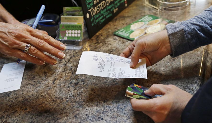 In this Wednesday, Sept. 28, 2016, photo, a customer buys lunch at Smolak Farms, in North Andover, Mass. On Friday, Oct. 28, 2016, the Commerce Department issues the first of three estimates of how the U.S. economy performed in the July-September quarter. (AP Photo/Elise Amendola)