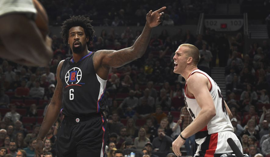 Portland Trail Blazers forward Mason Plumlee, right, reacts after he was fouled by Los Angeles Clippers center DeAndre Jordan during the third quarter of an NBA basketball game in Portland, Ore., Thursday, Oct. 27, 2016. The Clippers won 114-106. (AP Photo/Steve Dykes)