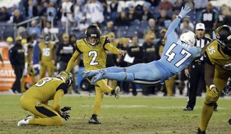Tennessee Titans defensive back Valentino Blake (47) dives as he tries to block an extra point by Jacksonville Jaguars kicker Jason Myers (2) in the second half of an NFL football game Thursday, Oct. 27, 2016, in Nashville, Tenn. The Titans won 36-22. (AP Photo/James Kenney)