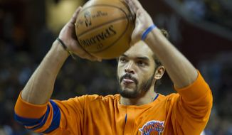 New York Knicks' Joakim Noah (13) warms up before a basketball game against the Cleveland Cavaliers in Cleveland, Tuesday, Oct. 25, 2016. (AP Photo/Phil Long)