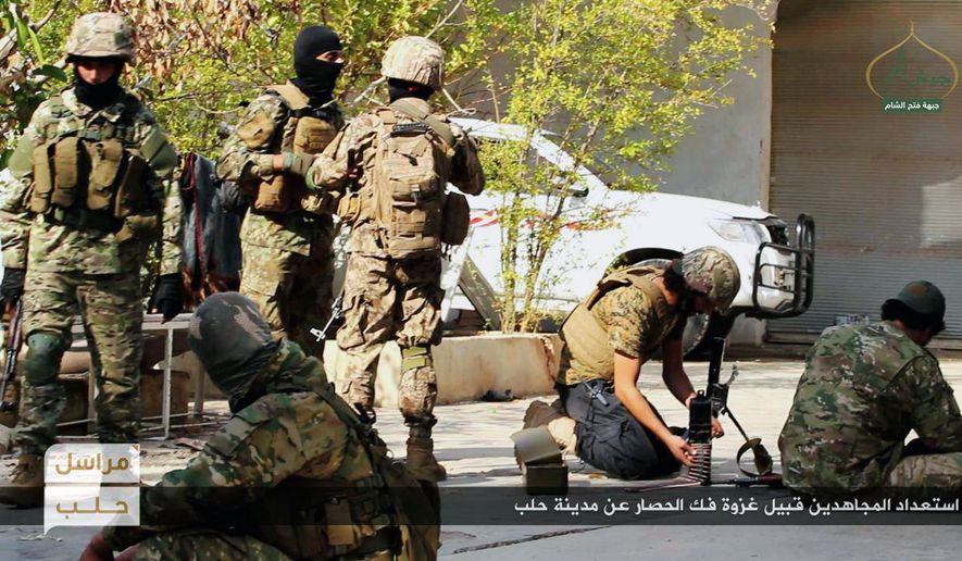 "This photo released online on Friday, Oct. 28, 2016, by the website of the al Qaeda-linked Fatah al-Sham, an anti-government militant group, shows fighters from the al Qaeda-linked Fatah al-Sham Front preparing for the offensive on government positions in the northern Syrian province of Aleppo. Fierce fighting broke out around the northern Syrian city of Aleppo Friday as rebels announced a large-scale offensive to break the government's nearly two-month siege of opposition-held areas. Arabic, bottom, reads: ""Holy warriors getting ready for the battle to break the siege of Aleppo."" (militant photo via AP)"