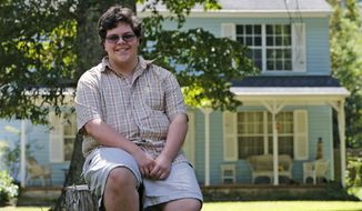 FILE - In this Aug. 22, 2016 file photo, transgender high school student Gavin Grimm poses in Gloucester, Va. The Supreme Court will take up transgender rights for the first time in the case of a Virginia school board that wants to prevent a transgender teenager from using the boys' bathroom at his high school.  (AP Photo/Steve Helber, File)