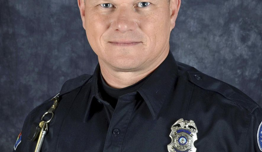 FILE - This undated file photo provided by the Albuquerque (N.M.) Police Department shows Officer Dan Webster. Webster was shot during a traffic stop on Oct. 21, 2015, and  died early Thursday, Oct. 29, 2015.  A federal judge found Davon Lymon, an ex-convict guilty Friday, Oct. 28, 2016 of illegally possessing a pistol that police say was used to kill an Albuquerque police officer during a nighttime traffic stop last year. (Albuquerque Police Department via AP, File)