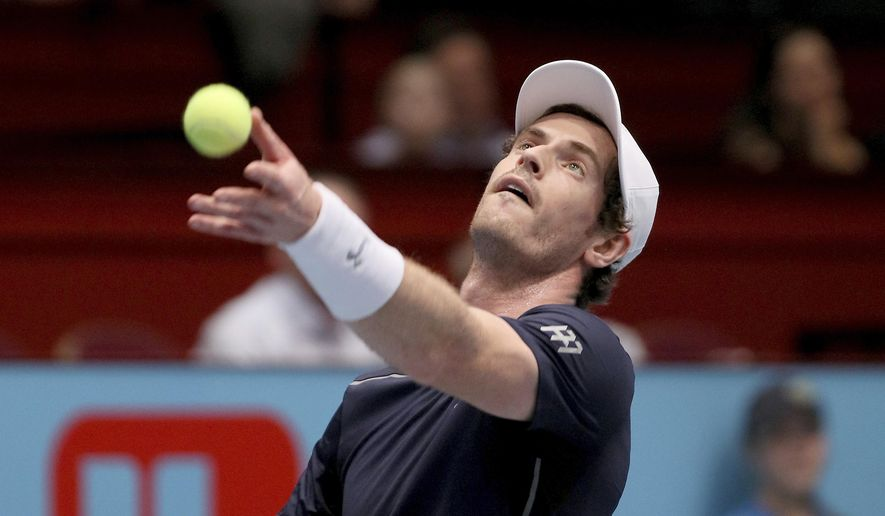 Andy Murray of Great Britain serves the ball to John Isner of the United States during their quarter final match at the Erste Bank Open tennis tournament in Vienna, Austria, Friday, Oct. 28, 2016. (AP Photo/Ronald Zak)