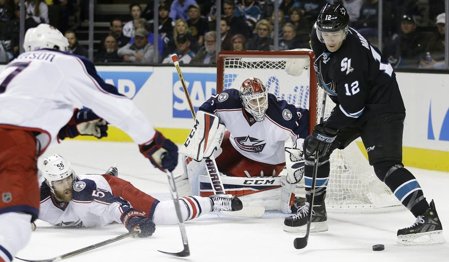 Columbus Blue Jackets goalie Sergei Bobrovsky, center, defends against San Jose Sharks' Patrick Marleau (12) during the first period of an NHL hockey game Thursday, Oct. 27, 2016, in San Jose, Calif. Blue Jackets' David Savard (58). (AP Photo/Ben Margot)