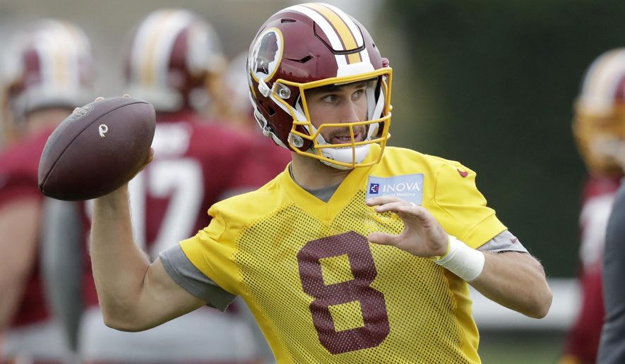 Washington Redskins' quarterback Kirk Cousins takes part in a training session at Wasps rugby union team training ground in west London, Friday, Oct. 28, 2016. The Washington Redskins are due to play the Cincinnati Bengals at Wembley stadium in London on Sunday in a regular season NFL game. (AP Photo/Matt Dunham)