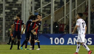Players of Argentina's San Lorenzo celebrate after their match against Chile's Palestino after Copa Sudamericana soccer match in Santiago, Chile, Thursday, Oct. 27, 2016. (AP Photo / Esteban Felix)