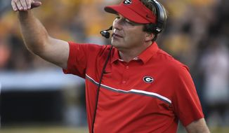 FILE - In this Sept. 17, 2016, file photo, Georgia head coach Kirby Smart watches from the sideline during the first half of an NCAA college football game against Missouri in Columbia, Mo. The Florida-Georgia rivalry begins a new era Saturday, Oct. 29, 2016, with Smart making his head-coaching debut in the neutral-site game. (AP Photo/L.G. Patterson, File)