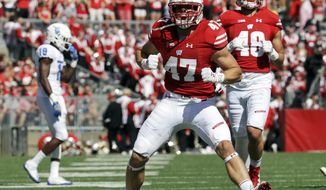 FILE - In this Sept. 17, 2016, file photo, Wisconsin's Vince Biegel (47) celebrates after breaking up a third down play during the first half of an NCAA college football game against Georgia State, in Madison, Wis. The tested Badgers are facing their fifth Top 10 opponent this season when they host No. 7 Nebraska on Saturday. (AP Photo/Morry Gash, File)