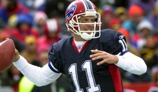 FILE - In this Dec. 1, 2002, file photo, Buffalo Bills quarterback Drew Bledsoe (11) looks to pass during an NFL football game against the Miami Dolphins in Orchard Park, N.Y. Bills safety Corey Graham was attending high school in Buffalo and has only a vague recollection of the blockbuster trade his hometown team made to acquire Bledsoe from New England in April 2002. (AP Photo/David Duprey, File)