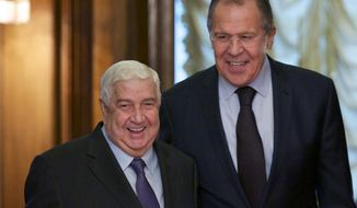 Russian Foreign Minister Sergey Lavrov, right, welcomes his Syrian counterpart Walid al-Moallem during their meeting in Moscow, Russia, Friday, Oct. 28, 2016. (AP Photo/Ivan Sekretarev)