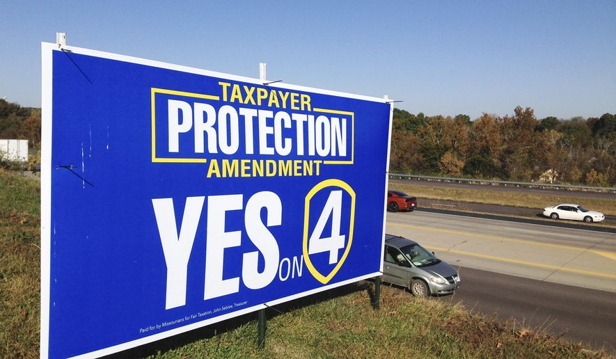 In this Monday, Oct. 24, 2016 photo, vehicles pass by a sign promoting Constitutional Amendment 4 in Jefferson City, Mo. The proposal on the November ballot would amend Missouri's constitution to prohibit the expansion of sales taxes to any services not already taxed. It's a first-of-its-kind measure nationally, in response to efforts in various states to expand sales taxes to services. (AP Photo/David A. Lieb)