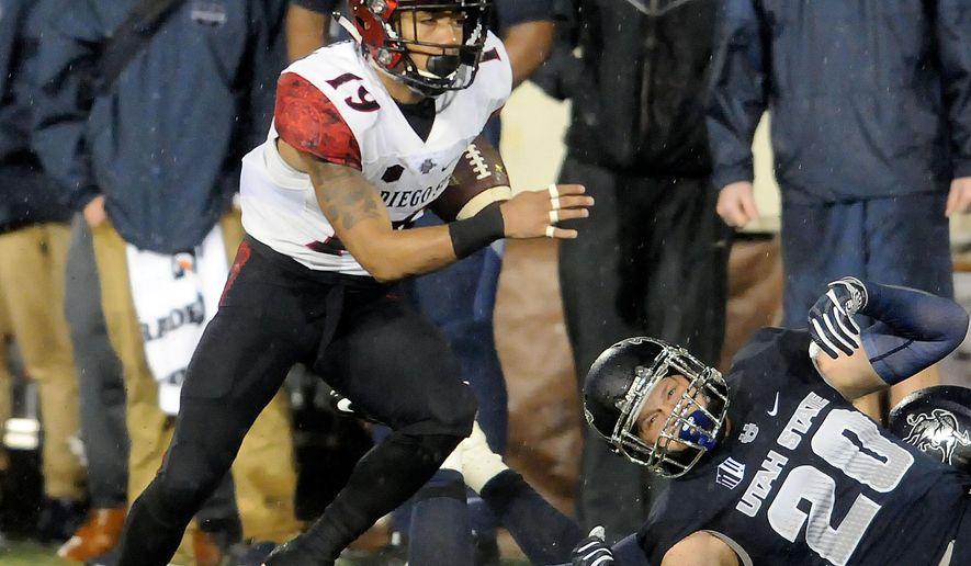 San Diego State running back Donnel Pumphrey (19) runs past Utah State's Brock Carmen (20) during an NCAA college football game Friday, Oct. 28, 2016, in Logan, Utah. (Eli Lucero/Herald Journal via AP)
