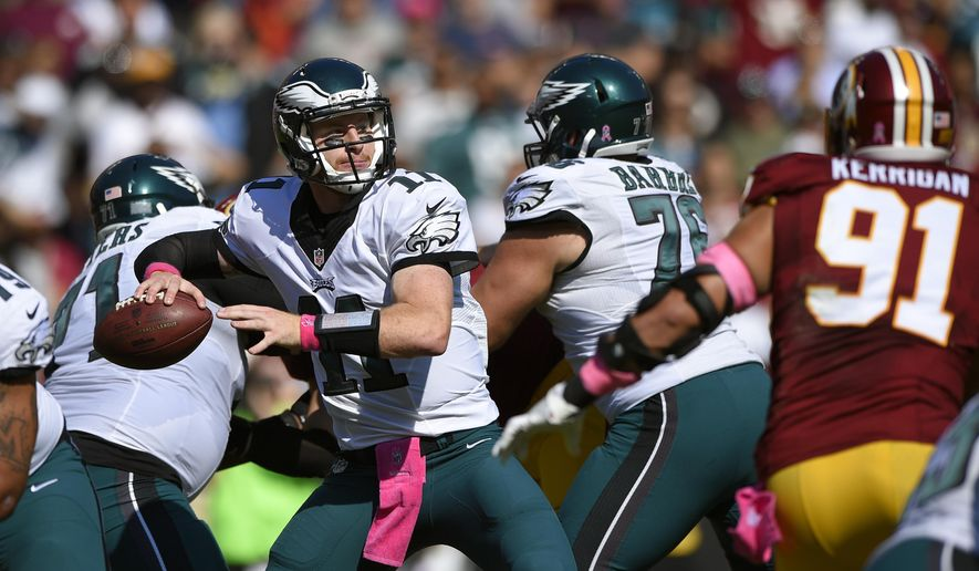FILE - In this Sunday, Oct. 16, 2016, file photo, Philadelphia Eagles quarterback Carson Wentz throws to a receiver in the first half of an NFL football game against the Washington Redskins in Landover, Md. Even if deals are few and far between during an NFL season, every team _ some more than others _ could use help at Tuesday's deadline for making trades. (AP Photo/Nick Wass, File)