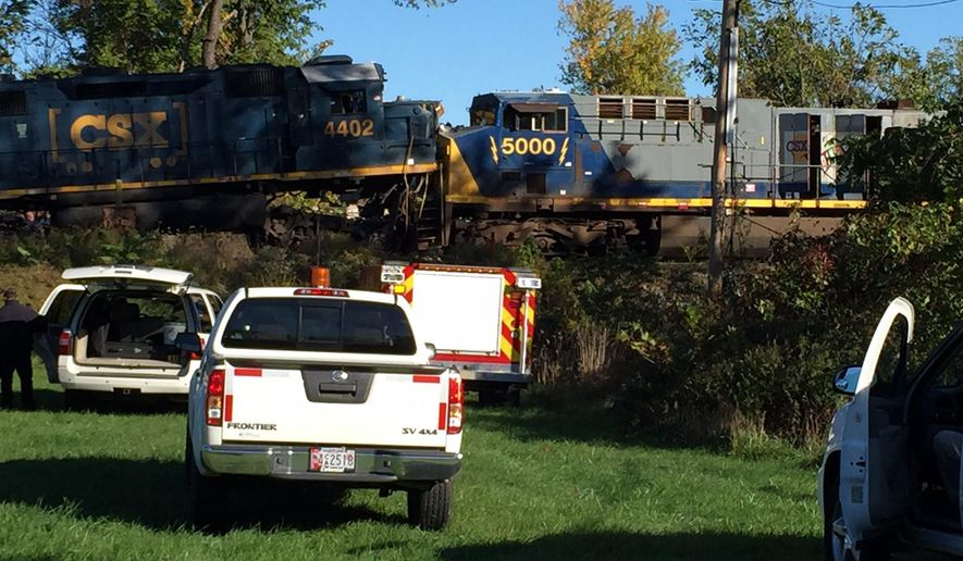 Authorities arrive at the scene where freight trains have crashed head on, Friday, Oct. 28, 2016 in Chester Township, Pa.  A CSX spokesman says an empty freight train traveling to Pavonia, N.J. from Richmond, Va. collided Friday morning with another CSX train carrying consumer goods and food products to Atlanta from Quebec, Canada. Neither train was carrying hazardous materials.   (Mari Schaefer/The Philadelphia Inquirer via AP)
