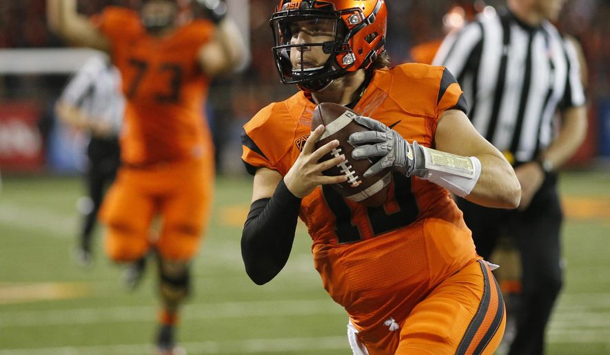 FILE - In this Oct. 8, 2016, file photo, Oregon State quarterback Darell Garretson runs into the end zone with the winning touchdown in overtime in an NCAA college football game against California, in Corvallis, Ore. Oregon State hosts Washington State on Saturday. (AP Photo/Timothy J. Gonzalez, File)