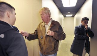 Libertarian vice presidential nominee Bill Weld speaks with a supporter prior to addressing a campaign rally in Anchorage, Alaska, Friday, Oct. 28, 2016. Campaign consultant Apollo Pazell is at right. Weld sees a receptive audience for his ticket's message in Alaska, a state where he's investing time in the run-up to the Nov. 8 general election. (AP Photo/Michael Dinneen)