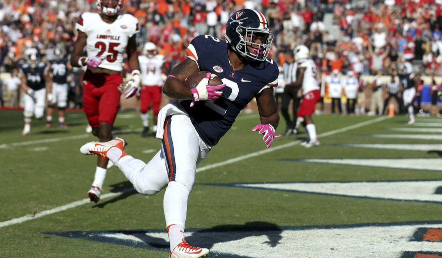 Virginia tailback Albert Reid (2) scores a two-point conversion during the second half of an NCAA college football game against Louisville, Saturday, Oct. 29, 2016 in Charlottesville, Va. Louisville defeated Virginia 32-25. (AP Photo/Ryan M. Kelly)