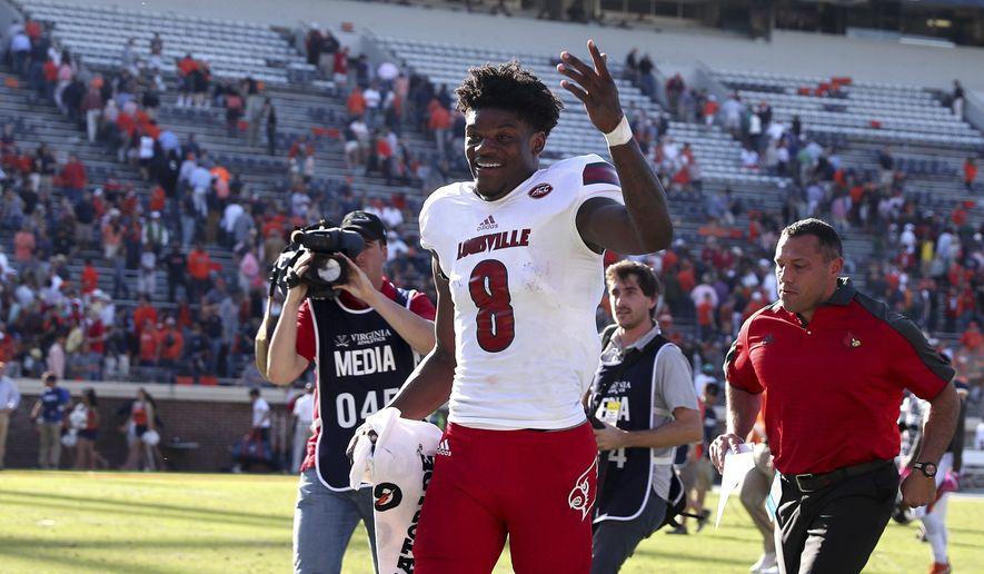 Louisville quarterback Lamar Jackson (8) walks off the field after an NCAA college football game against Virginia, Saturday, Oct. 29, 2016 in Charlottesville, Va. Louisville defeated Virginia 32-25. (AP Photo/Ryan M. Kelly)
