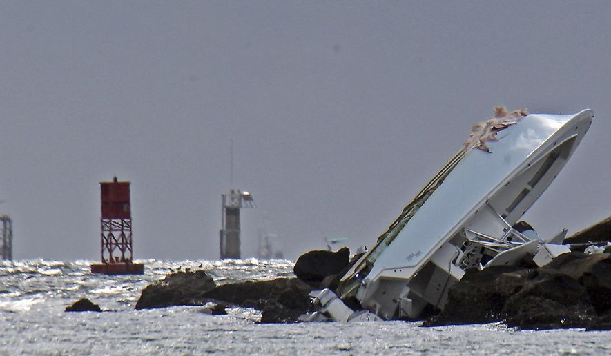 "FILE - In this Sept. 25, 2016, file photo, a boat lies overturned on a jetty off Miami Beach, Fla., in a crash that killed Miami Marlins starting pitcher Jose Fernandez and two others. Toxicology reports show Fernandez had cocaine and alcohol in his system when his boat crashed into a Miami Beach jetty. The cause of death was listed as ""boat crash"" in the autopsy report released Saturday, Oct. 29, 2016, by the Miami-Dade County Medical Examiner's Office. (Patrick Farrell/Miami Herald via AP, File)"