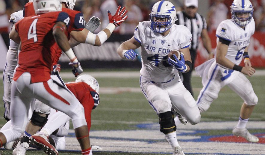 Air Force's Shayne Davern looks for running room as Fresno State's Mike Bell closes in during the first half of an NCAA college football game in Fresno, Calif., Friday, Oct. 28, 2016. (AP Photo/Gary Kazanjian)