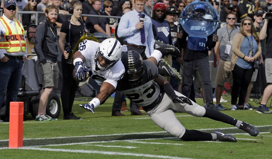 Penn State running back Saquon Barkley (26) dives short of the goal line as he's hit by Purdue cornerback Josh Hayes (23) during the first half of an NCAA college football game in West Lafayette, Ind., Saturday, Oct. 29, 2016. (AP Photo/Michael Conroy)