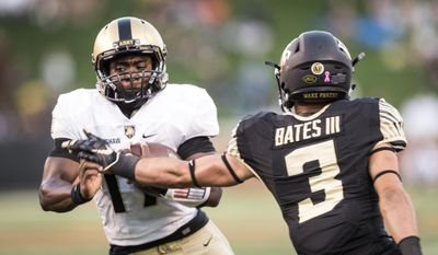 Army quarterback Ahmad Bradshaw dodges a tackle from Wake Forest safety Jessie Bates (3) on his way to a touchdown during an NCAA college football game Saturday, Oct. 29, 2016, in Winston-Salem, N.C. (Andrew Dye/The Winston-Salem Journal via AP)