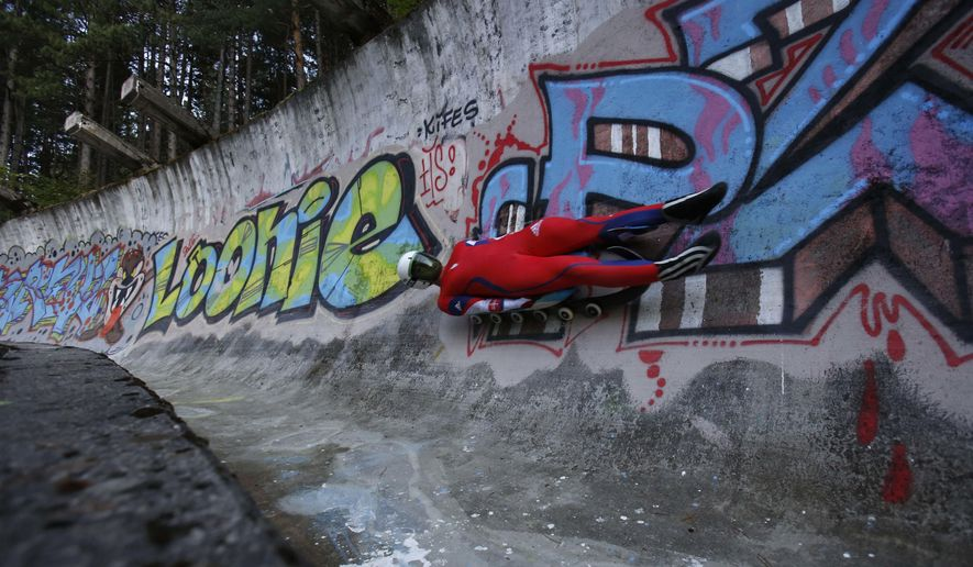 In this photo taken on Tuesday, Sept. 13, 2016, a member of the Slovak luge team practices on a bob and luge track on mount Trebevic near Sarajevo. Sports enthusiasts and former athletes in Bosnia have taken it upon themselves to reclaim some of the glory Sarajevo savored as host of the 1984 Olympics - and in the process rekindled the flame of international cooperation. Since the country lacks the resources to rebuild the Olympic facilities that were destroyed in the deadly war that followed the breakup of Yugoslavia, volunteers bought tools, rolled up their sleeves and got to work. (AP Photo/Amel Emric)