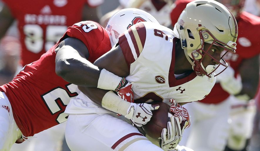 Boston College wide receiver Jeff Smith (6) carries the ball as North Carolina State cornerback Jack Tocho (29) moves in to make the tackle during the first half of an NCAA college football game in Raleigh, N.C., Saturday, Oct. 29, 2016. (AP Photo/Gerry Broome)