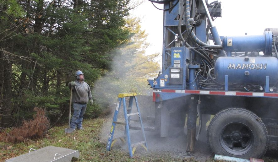 In this Thursday, Oct. 27, 2016 photo, Jesse Aubie drills a new drinking water well in Topsham, Vt. Despite recent rain and snow, much of Vermont is now in a drought and the state is asking residents to conserve water when possible and report shortages. (AP Photo/Lisa Rathke)