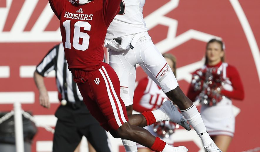 Indiana defensive back Rashard Fant (16) disrupts this pass to Maryland wide receiver Levern Jacobs (8) during the first half of an NCAA college football game in Bloomington, Ind., Saturday, Oct. 29, 2016. (AP Photo/Sam Riche)