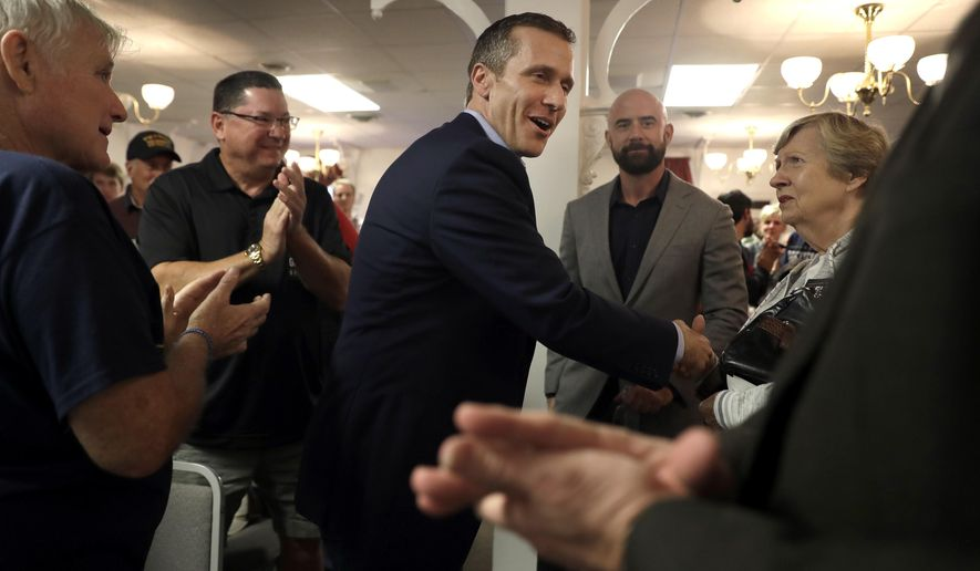 Missouri Republican gubernatorial candidate Eric Greitens shakes hands with supporters during a campaign stop Wednesday, Oct. 26, 2016, in Kirkwood, Mo. (AP Photo/Jeff Roberson)
