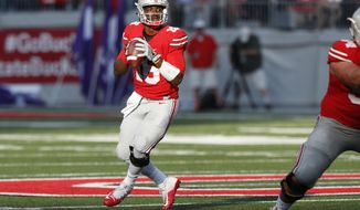 Ohio State quarterback J.T. Barrett drops back to pass against Northwestern during the first half of an NCAA college football game Saturday, Oct. 29, 2016, in Columbus, Ohio. (AP Photo/Jay LaPrete)