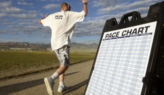 Inmates at the Utah State Prison in Draper, Utah, run the enclosed exercise yard-track at the start of the Draper Invitational Marathon, Half-Marathon and 10K races Tuesday morning October 25 2016.  Runners can refer to a pace chart to stay on course for the 110 laps of the full Marathon. (Al Hartmann/Salt Lake Tribune via AP)