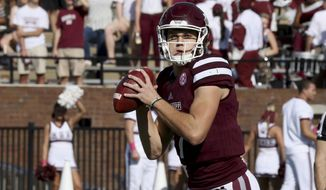 Mississippi State quarterback Nick Fitzgerald (7) prepares to pass during the first half of their NCAA college football game against Samford in Starkville, Miss., Saturday, Oct. 29, 2016. (AP Photo/Jim Lytle)