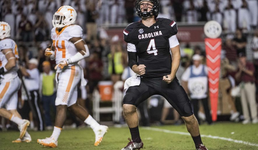 South Carolina quarterback Jake Bentley (4) celebrates a touchdown during the first half of an NCAA college football game against Tennessee Saturday, Oct. 29, 2016, in Columbia, S.C. (AP Photo/Sean Rayford)