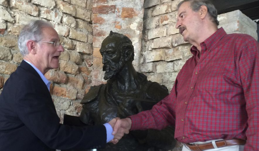 Former Mexico President Vicente Fox, right, gives Tucson Mayor Jonathan Rothschild a tour of his foundation in Guanajuato, Mexico, on Oct. 25, 2016. (Gabriela Rico/Arizona Daily Star via AP)